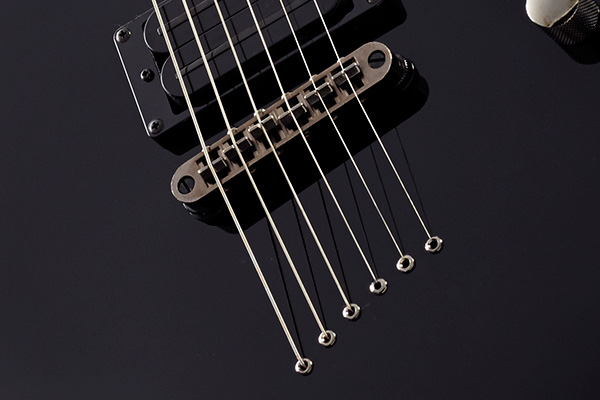 MD200BK String-through body design and bridge